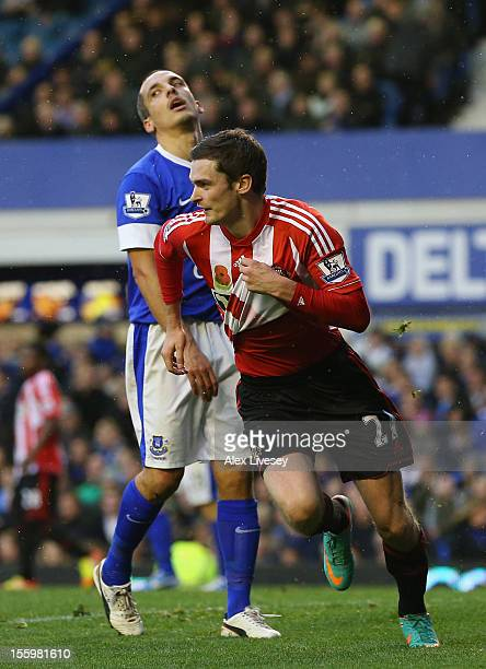 Adam Johnson of Sunderland celebrates after scoring the opening goal as Leon Osman of Everton looks on during the Barclays Premier League match...