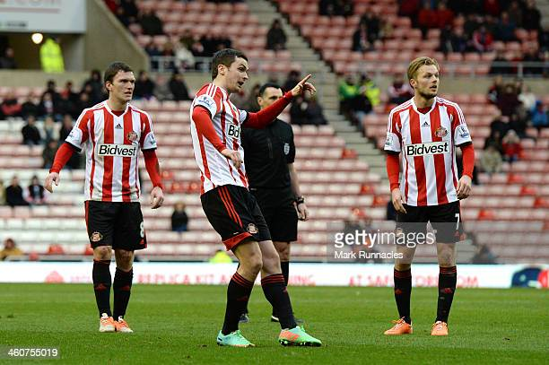 Adam Johnson of Sunderland celebrates after scoring the opening goal from a free kick during the Budweiser FA Cup third round match between...