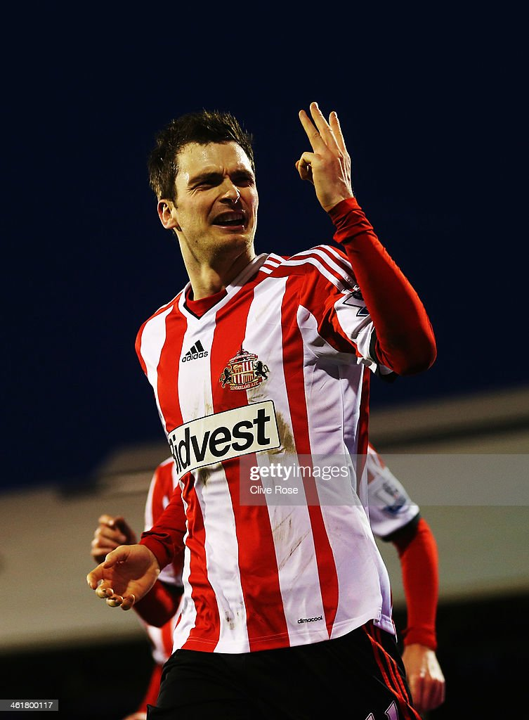 Adam Johnson of Sunderland celebrates scoring a hat trick during the Barclays Premier League match between Fulham and Sunderland at Craven Cottage on January 11, 2014 in London, England.