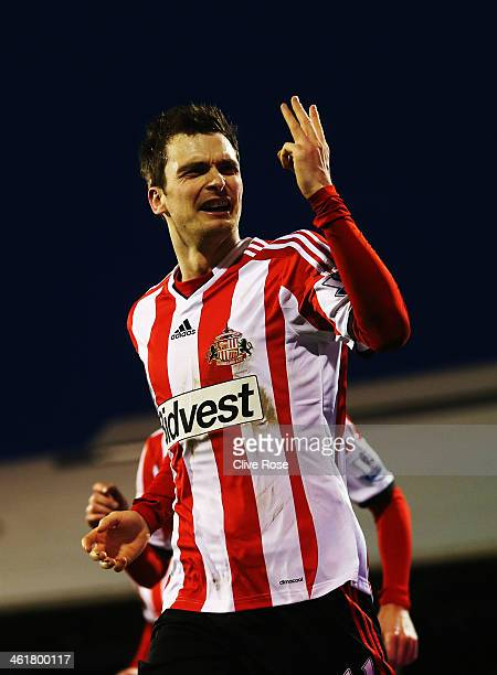Adam Johnson of Sunderland celebrates scoring a hat trick during the Barclays Premier League match between Fulham and Sunderland at Craven Cottage on...