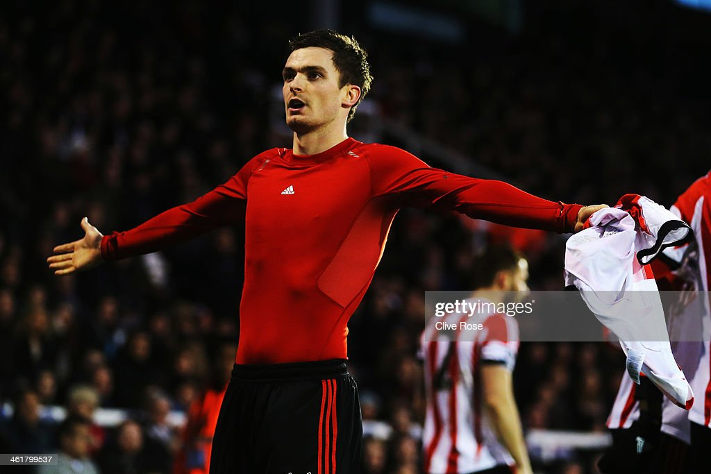 Adam Johnson of Sunderland celebrates scoring his sides third goal during the Barclays Premier League match between Fulham and Sunderland at Craven Cottage on January 11, 2014 in London, England.