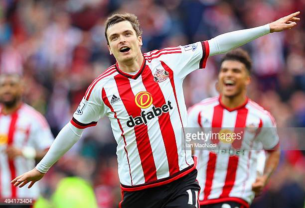 Adam Johnson of Sunderland celebrates scoring his team's first goal from the penalty spot during the Barclays Premier League match between Sunderland...
