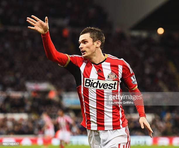 Adam Johnson of Sunderland celebrates scoring the opening goal during the Barclays Premier League match between Newcastle United and Sunderland at St...