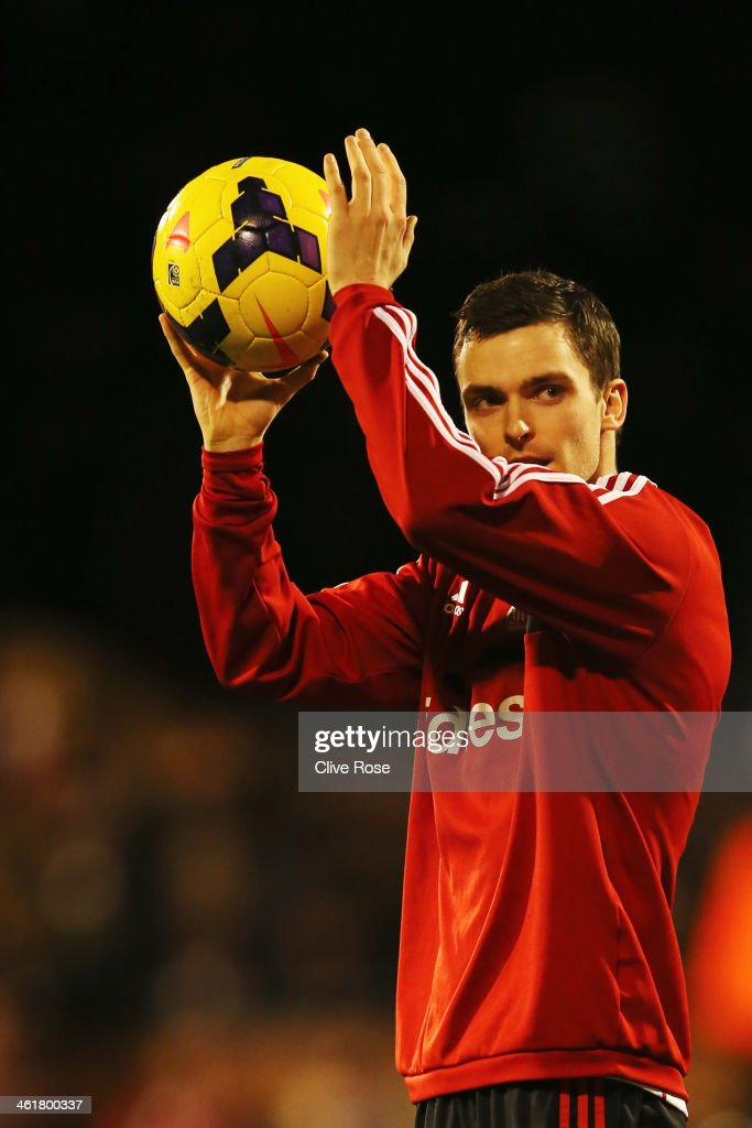 Adam Johnson of Sunderland celebrates with the match ball after scoring a hat trick during the Barclays Premier League match between Fulham and Sunderland at Craven Cottage on January 11, 2014 in London, England.