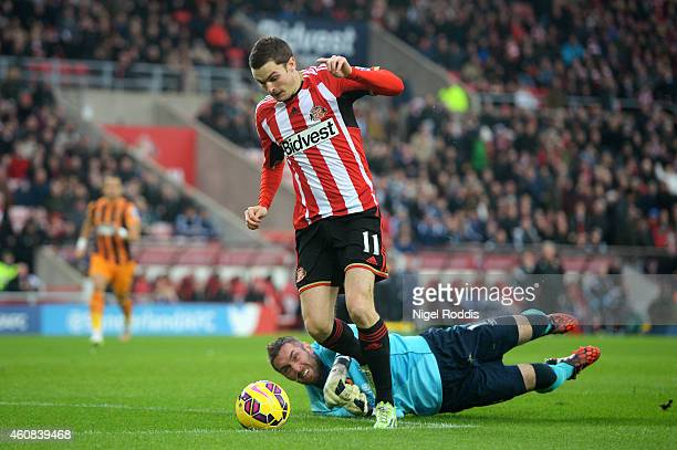 Adam Johnson of Sunderland rounds goalkeeper Allan McGregor of Hull City to score the opening goal following a poor back pass during the Barclays...