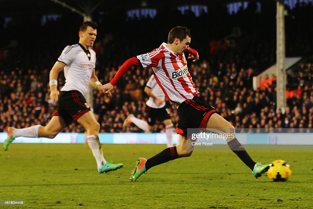 Adam Johnson of Sunderland scores his sides third goal during the Barclays Premier League match between Fulham and Sunderland at Craven Cottage on January 11, 2014 in London, England.