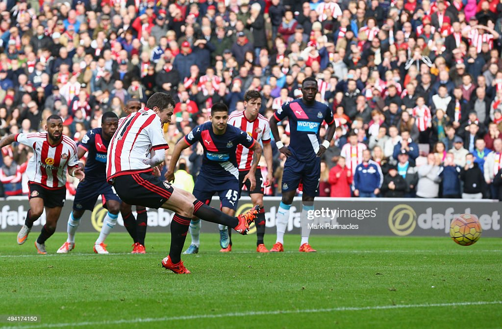 Adam Johnson of Sunderland scores his team's first goal from the penalty spot during the Barclays Premier League match between Sunderland and Newcastle United at Stadium of Light on October 25, 2015 in Sunderland, England.