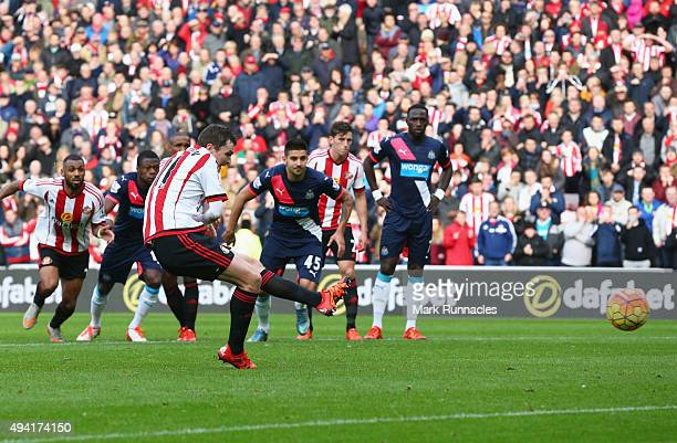 Adam Johnson of Sunderland scores his team's first goal from the penalty spot during the Barclays Premier League match between Sunderland and...