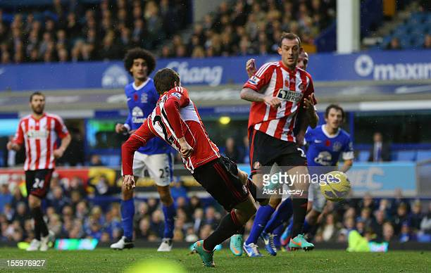 Adam Johnson of Sunderland scores the opening goal during the Barclays Premier League match between Everton and Sunderland at Goodison Park on...