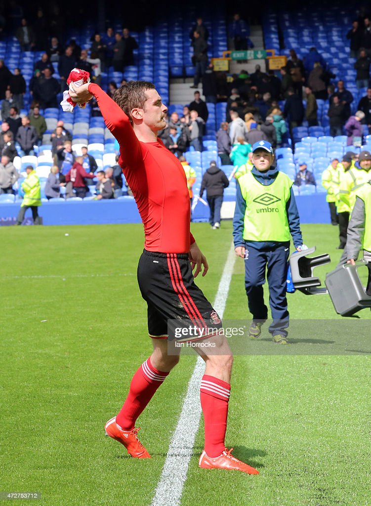 Adam Johnson of Sunderland throws his shirt to the crowd during the Barclays Premier League match between Everton and Sunderland at Goodison Park on May 09, 2015 in Liverpool, England.