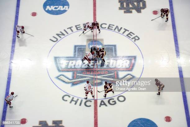 Adam Johnson of the MinnesotaDuluth Bulldogs and Dylan Gambrell of the Denver Pioneers faceoff during the 2017 NCAA Photos via Getty Images Div I...