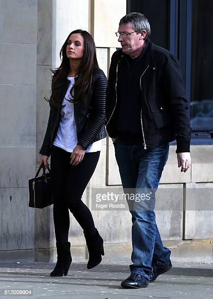 Adam Johnson's partner Stacey Flounders arrives at lunchtime accompanied by the footballer's father Dave Johnson on day nine of the trial of...