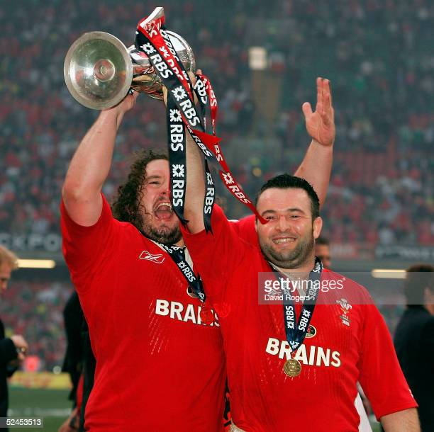 Adam Jones and Mefin Davies hold the trophy aloft as Wales win the Grand Slam after defeating Ireland in the RBS Six Nations International between...