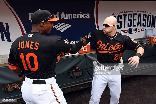Adam Jones and Steve Pearce of the Baltimore Orioles celebrate in the dugout during Game Two of the American League Division Series against the...