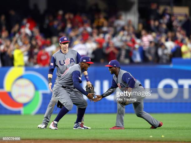 Adam Jones Christian Yelich and Andrew McCutchen of Team USA celebrate after the final out of Game 6 of Pool F of the 2017 World Baseball Classic...