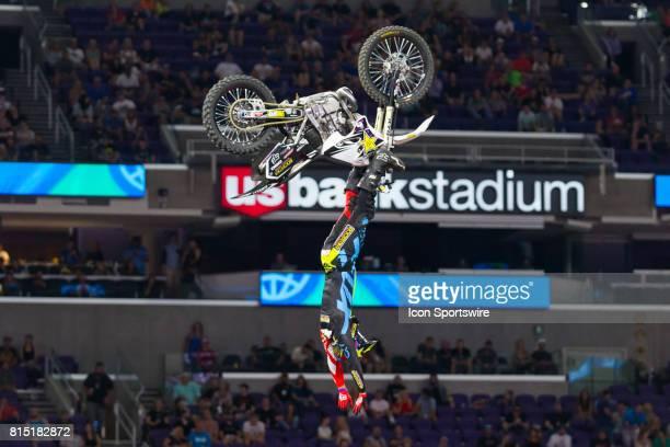 Adam Jones hangs from his bike during Moto X Freestyle at X Games Minneapolis on July 14 2017 at US Bank Stadium in Minneapolis Minnesota