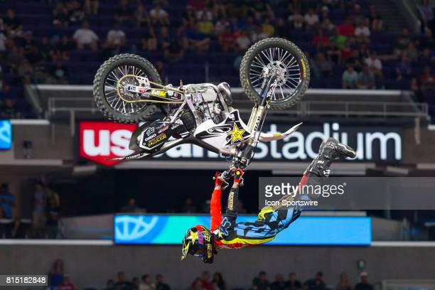 Adam Jones hangs from his dirtbike during Moto X Freestyle at X Games Minneapolis on July 14 2017 at US Bank Stadium in Minneapolis Minnesota
