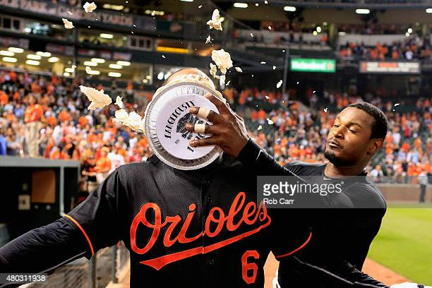 Adam Jones hits Jonathan Schoop of the Baltimore Orioles with a pie after Schoop hit a walk off home run giving the Orioles a 3-2 win over the...