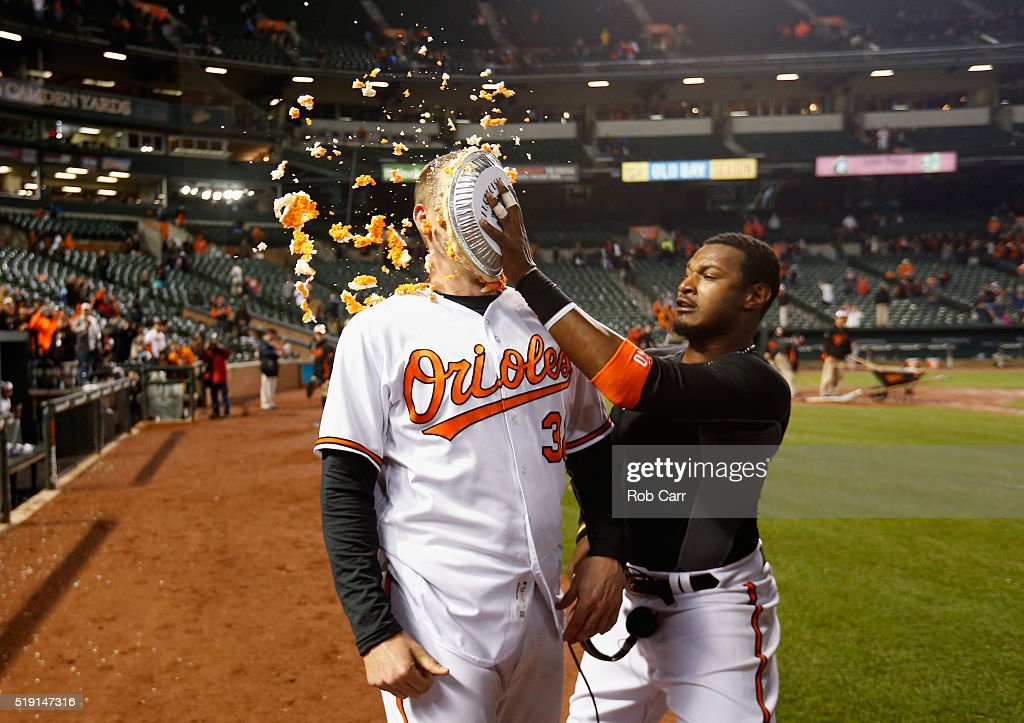 Adam Jones #10 (R) hits Matt Wieters #32 of the Baltimore Orioles in the face with pie after the Orioles defeated the Minnesota Twins 3-2 during their Opening Day game Oriole Park at Camden Yards on April 4, 2016 in Baltimore, Maryland.
