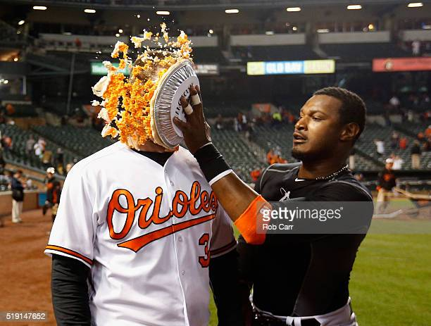 Adam Jones hits Matt Wieters of the Baltimore Orioles in the face with pie after the Orioles defeated the Minnesota Twins 32 during their Opening Day...