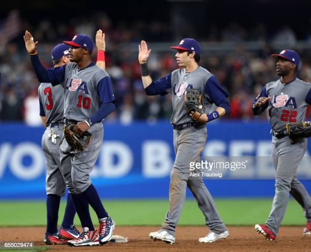 Adam Jones Ian Kinsler and Christian Yelich of Team USA celebrate after the final out of Game 6 of Pool F of the 2017 World Baseball Classic against...