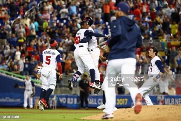 Adam Jones of Team USA celebrates with teammates after hitting a walk off single in the bottom of the 10th inning during Game 2 Pool C of the 2017...