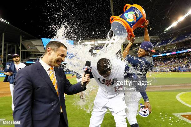 Adam Jones of Team USA gets doused with a water cooler by Chris Archer after Team USA beat Team Colombia in 10 innings in Game 2 Pool C of the 2017...