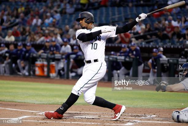 Adam Jones of the Arizona Diamondbacks swings at a pitch against the San Diego Padres during the first inning of an MLB game at Chase Field on April...