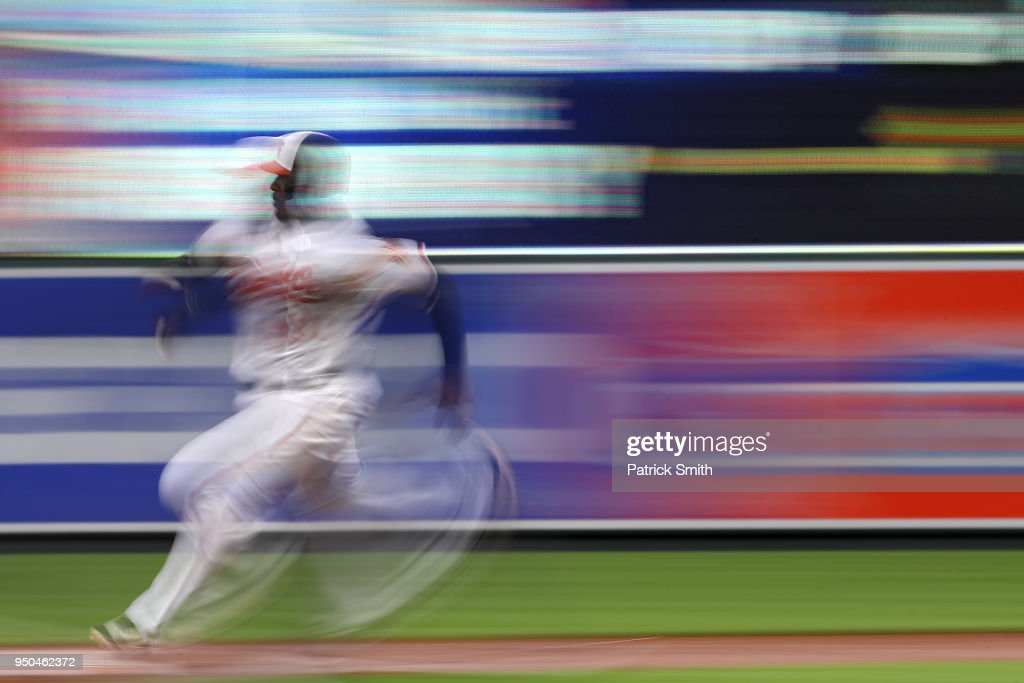 Adam Jones #10 of the Baltimore Orioles advances bases on a hit by teammates Chris Davis #19 (not pictured) against the Cleveland Indians during the second inning at Oriole Park at Camden Yards on April 23, 2018 in Baltimore, Maryland.