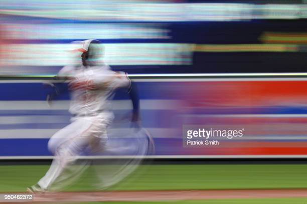 Adam Jones of the Baltimore Orioles advances bases on a hit by teammates Chris Davis against the Cleveland Indians during the second inning at Oriole...