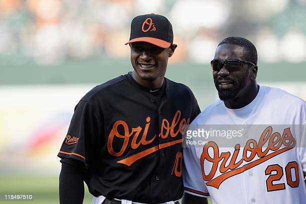 Adam Jones of the Baltimore Orioles and Baltimore Ravens safety Ed Reed after Reed threw out the ceremonial first pitch before the start of the...