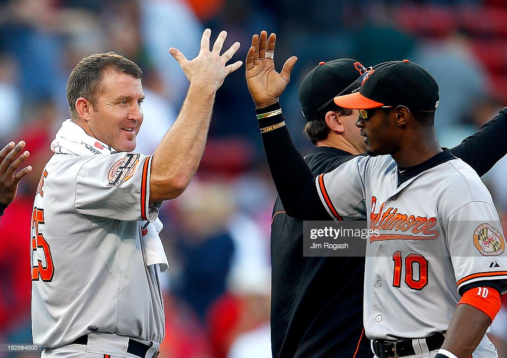 Adam Jones #10 of the Baltimore Orioles and Jim Thome #25 celebrate a 9-6 win over the Boston Red Sox at Fenway Park on September 22, 2012 in Boston, Massachusetts.