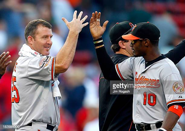 Adam Jones of the Baltimore Orioles and Jim Thome celebrate a 96 win over the Boston Red Sox at Fenway Park on September 22 2012 in Boston...