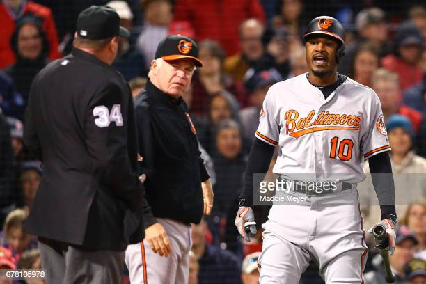 Adam Jones of the Baltimore Orioles and Manager Buck Showalter argue with umpire Sam Holbrook after Jones was ejected during the fifth inning against...