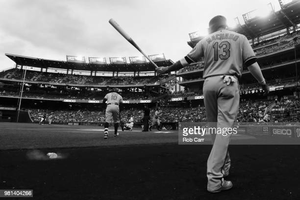 Adam Jones of the Baltimore Orioles bats as Manny Machado waits on deck in the first inning against the Washington Nationals at Nationals Park on...