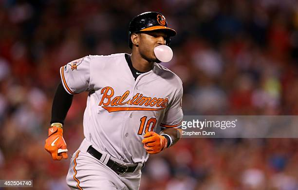 Adam Jones of the Baltimore Orioles blows a bubble as he rounds first base after hitting his second two run home run of the game against Los Angeles...