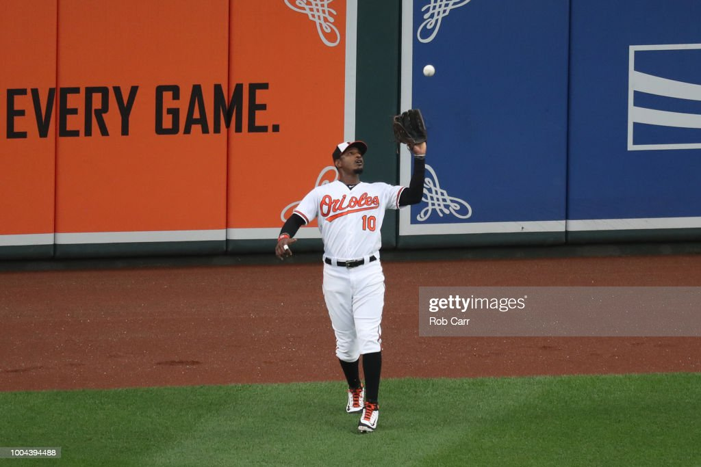 Adam Jones #10 of the Baltimore Orioles catches a ball hit by Mookie Betts #50 of the Boston Red Sox (not pictured) for the first out of the first inning at Oriole Park at Camden Yards on July 23, 2018 in Baltimore, Maryland.
