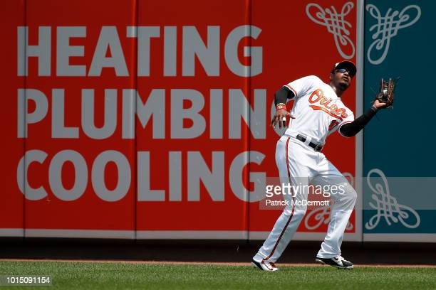 Adam Jones of the Baltimore Orioles catches a fly ball hit by Mookie Betts of the Boston Red Sox in the first inning during game one of a...