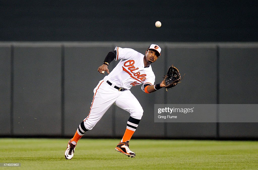 Adam Jones #10 of the Baltimore Orioles catches a fly ball in the ninth inning off the bat of Mike Zunino (not pictured) of the Seattle Mariners at Oriole Park at Camden Yards on May 19, 2015 in Baltimore, Maryland. Baltimore won the game 9-4.