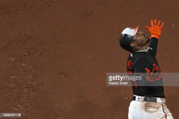 Adam Jones of the Baltimore Orioles celebrates after hitting a three run home run against the Tampa Bay Rays during the seventh inning at Oriole Park...