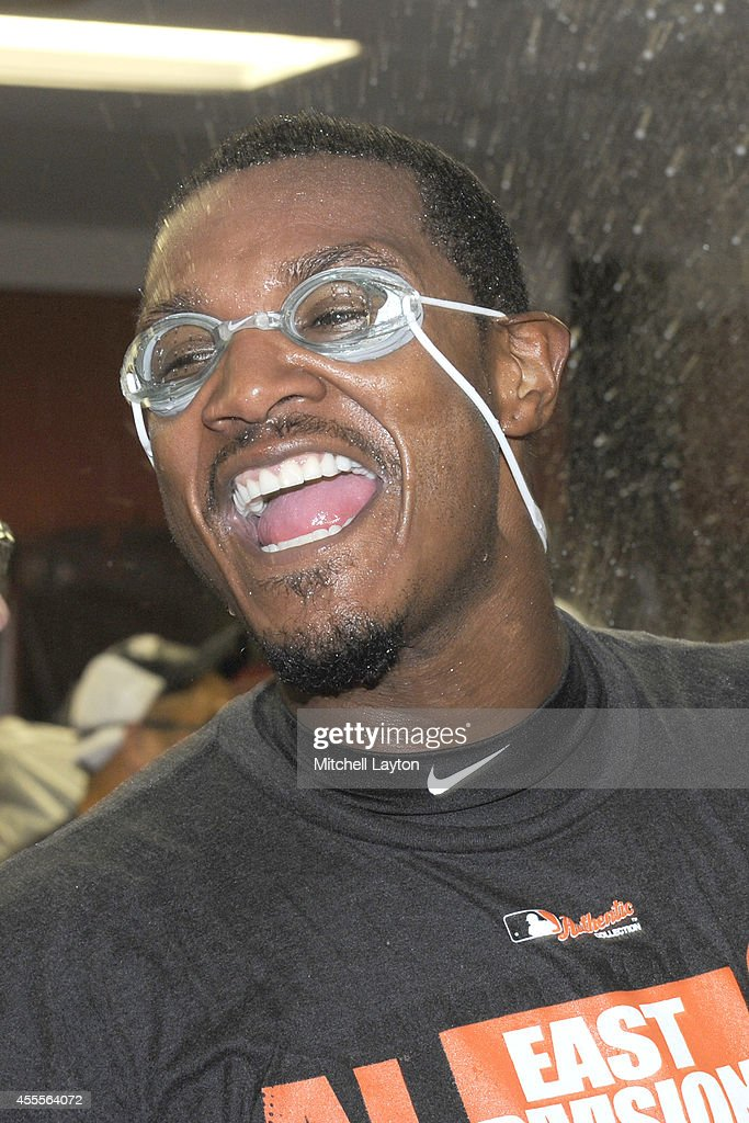 Adam Jones #10 of the Baltimore Orioles celebrates in locker room after the Orioles clinch the American League East Division after a baseball game against the Toronto Blue Jays on September 16, 2014 at Oriole Park at Camden Yards in Baltimore, Maryland.