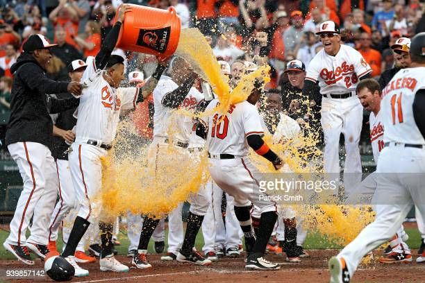 Adam Jones of the Baltimore Orioles celebrates with teammates after hitting a walkoff home run against the Minnesota Twins during the eleventh inning...