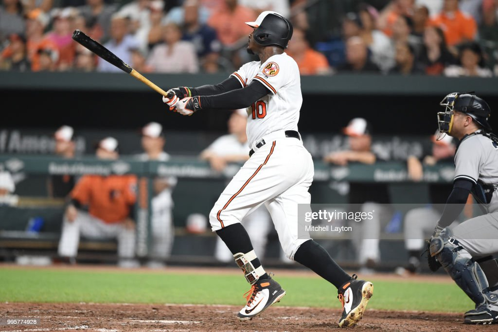 Adam Jones #10 of the Baltimore Orioles doubles in the ninth inning during a baseball game against the New York Yankees at Oriole Park at Camden Yards on July 10, 2018 in Baltimore, Maryland.
