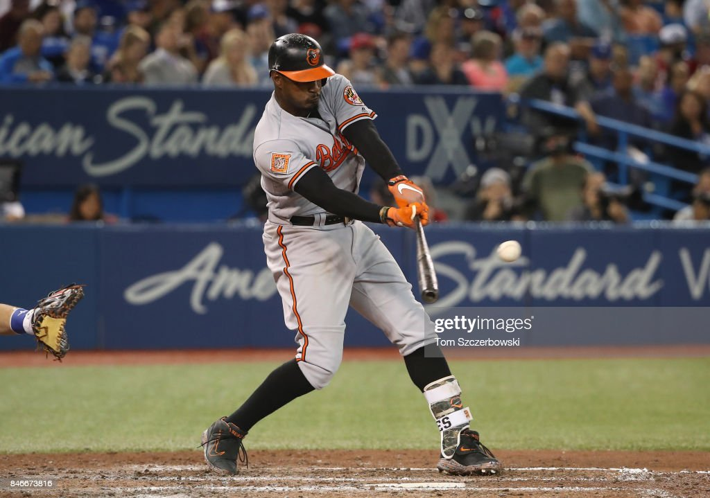 Adam Jones #10 of the Baltimore Orioles hits a double in the eighth inning during MLB game action against the Toronto Blue Jays at Rogers Centre on September 13, 2017 in Toronto, Canada.