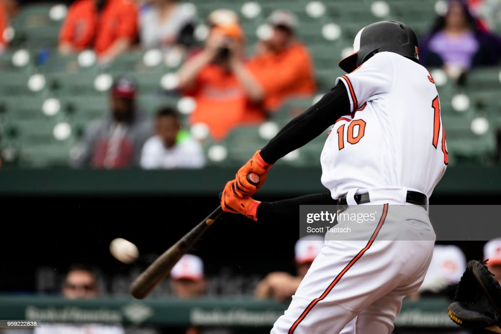 Adam Jones #10 of the Baltimore Orioles hits a home run during the first inning against the Philadelphia Phillies at Oriole Park at Camden Yards on May 16, 2018 in Baltimore, Maryland.