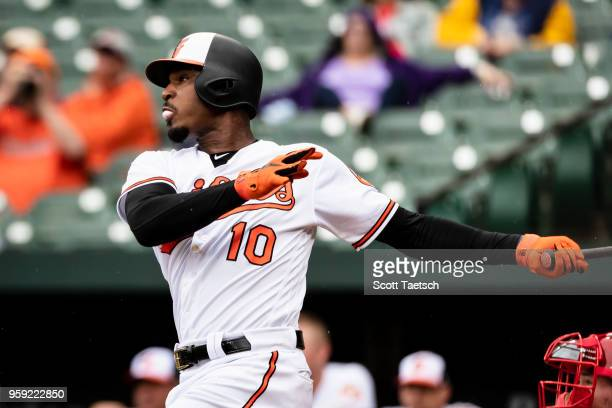 Adam Jones of the Baltimore Orioles hits a home run during the first inning against the Philadelphia Phillies at Oriole Park at Camden Yards on May...