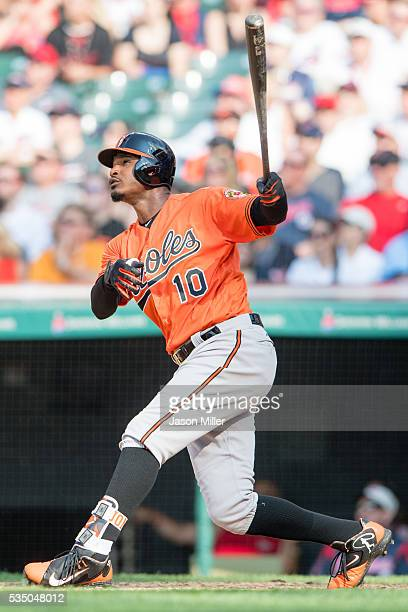 Adam Jones of the Baltimore Orioles hits a sacrifice fly during the fifth inning against the Cleveland Indians at Progressive Field on May 28 2016 in...