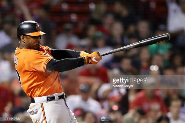 Adam Jones of the Baltimore Orioles hits a single during the seventh inning against the Boston Red Sox at Fenway Park on September 26 2018 in Boston...