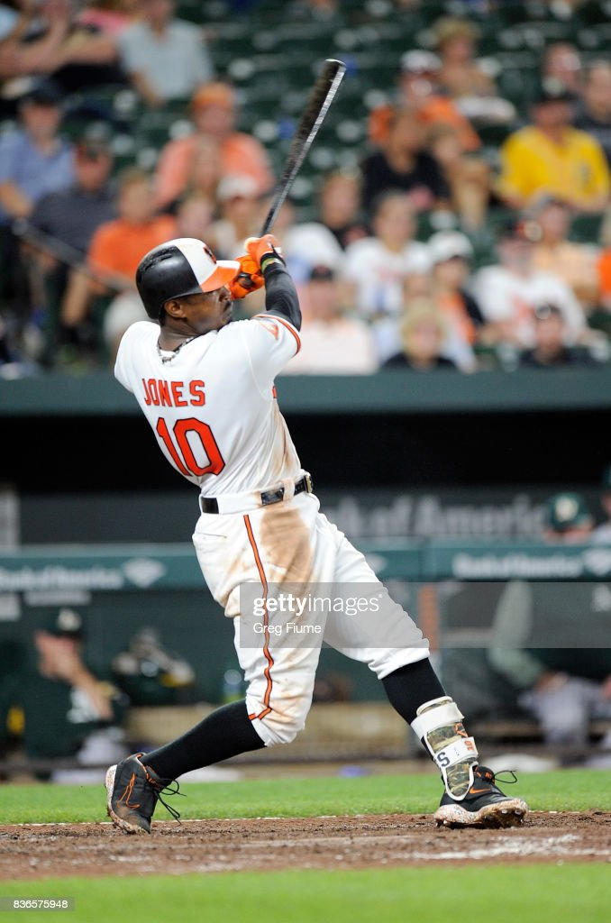 Adam Jones #10 of the Baltimore Orioles hits a single in the seventh inning against the Oakland Athletics at Oriole Park at Camden Yards on August 21, 2017 in Baltimore, Maryland.