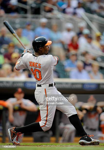 Adam Jones of the Baltimore Orioles hits a tworun home run against the Minnesota Twins during the first inning on July 18 2012 at Target Field in...